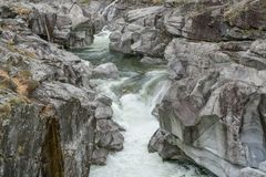 Fantastic view of a mountain river carving ist way through a wild rocky gorge. In southern Switzerland stock photography