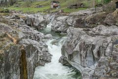 Fantastic view of a mountain river carving ist way through a wild rocky gorge. In southern Switzerland stock photos