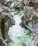 Fantastic view of a mountain river carving ist way through a wild rocky gorge in a wild mountain valley. Fantastic view of a mountain river carving ist way stock images