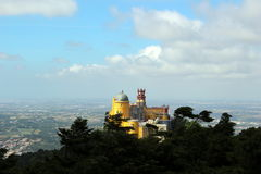 Fantastic view of the Pena Palace in windy weather. & x28;from the viewpoint of the Cruz Alta& x29;. Sintra, Portugal Royalty Free Stock Image