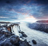 Fantastic views of Selfoss waterfall in the national park Vatnaj. Okull. Mysterious and mystical sunset in pink - orange. Iceland Royalty Free Stock Photos