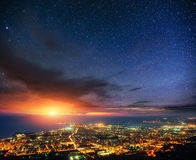 Fantastic views of the starry night sky above the city.  Stock Photography