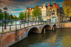 Fantastic water canals with bridges and colorful houses, Amsterdam, Netherlands stock photo