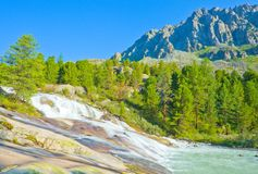 Fantastic waterfall in the Altai Mountains Stock Photo