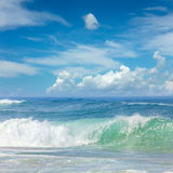 Fantastic Waves in the warm Sea Water and blue sky Royalty Free Stock Photo