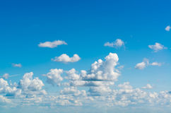 Fantastic white clouds against blue sky Stock Image