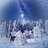 Fantastic winter landscape. Chalet under the stars. background w Stock Photos