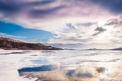 Fantastic winter landscape with frozen lake Royalty Free Stock Photo