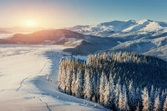 Fantastic winter landscape and worn trail leading into the mount Stock Photos