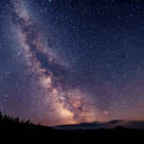 Fantastic winter meteor shower and the snow-capped mountains Royalty Free Stock Images