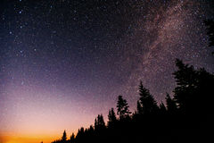 Fantastic winter meteor shower and the snow-capped mountains. Stock Photo