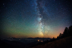 Fantastic winter meteor shower and the snow-capped mountains. Royalty Free Stock Images