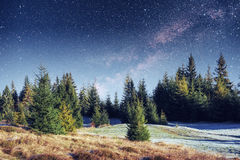 Fantastic winter meteor shower and the snow-capped mountains Stock Photography