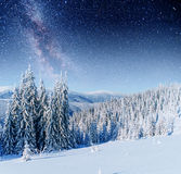 Fantastic winter meteor shower and the snow-capped mountains. Ca Stock Photos