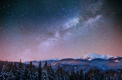 Fantastic winter meteor shower and the snow-capped mountains. Ca stock photography