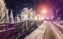 Fantastic winter, night scene. Snow Storm over the village. frosty evening stock photos
