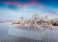 Fantastic winter sunriseon the frozen lake. Royalty Free Stock Photo