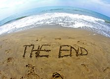 Fantastic writing THE END on the sea beach. With fisheye lens Royalty Free Stock Photography