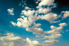 The fantastic yellow clouds. The fantastic yellow clouds on background blue sky. The Abstraction Stock Photos