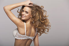 Fantastic young beauty wearing only bra Royalty Free Stock Photo