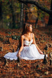 Fantastic young woman. beautiful fantasy girl fairy with white long dress in windy autumn park Stock Images