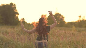 Fantastic young woman outdoors. Jumping and raising his hands to the sides. stock video footage