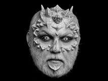 Fantastisch maak omhoog verschrikkingsmens of monster met doornen op gezicht met make-up stock afbeelding