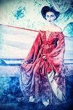 Fantasy. Bloodthirsty female vampire rises from the coffin on the night cemetery Royalty Free Stock Photo