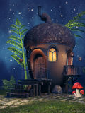 Fantasy acorn cottage. With mushrooms and fern at night Royalty Free Stock Photography