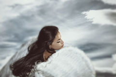 Fantasy angel. Woman with sky in background Stock Image