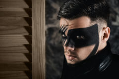 Fantasy art makeup. man with black painted mask on face. Close up Portrait. Professional Fashion Makeup. Royalty Free Stock Image