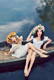 Fantasy art photo of a beautiful girls in boat Stock Photo