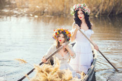 Fantasy art photo of a beautiful girls in boat Stock Photography