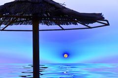 Fantasy art photo water, the sea, the moon above the water and the silhouette of the umbrella from the straw. Stock Photos