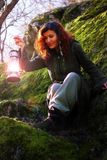 Fantasy beautiful woman with color light lamps in the moss rocks Stock Images