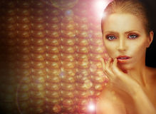 Fantasy. Beautiful Woman over Sparkling Gold Background stock image