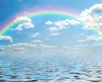 Fantasy of a blue sky and rainbow with cumulus clo Royalty Free Stock Image