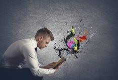 Fantasy book. Concept of fantasy book with ink spray Stock Photos