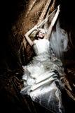 Fantasy bride. On golden dark background royalty free stock image