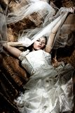 Fantasy bride. On golden dark background stock images
