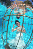 Fantasy bride underwater in a bird cage Stock Photography
