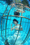 Fantasy bride underwater in a bird cage Royalty Free Stock Photography
