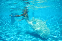 Fantasy bride underwater Stock Photos