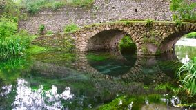 Fantasy bridge 4k stone arched reflection kingdom medieval river canal garden.  stock video