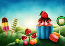 Fantasy candyland with cupcake Royalty Free Stock Image