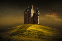 Fantasy castle behind the green grass hill stock images