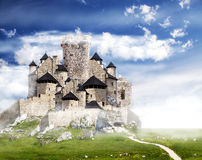 Fantasy castle with clouds. Royalty Free Stock Photography