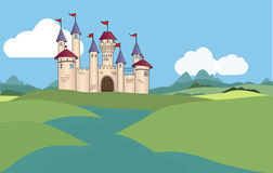 Fantasy Castle. In a kingdom far away there is a beautiful castle on a hill. It is surrounded by a moat and accessible by a bridge. Flags in the wind to greet Royalty Free Stock Photos