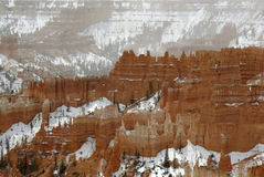 Fantasy Castles of Bryce Canyon. The eroded ridges of Bryce Canyon appear as fantasy castles against a mist of falling snow Stock Photos