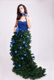 Fantasy Christmas concept of beautiful woman in fir dress Royalty Free Stock Photo